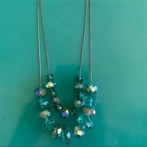 Blue-green beads on black wire